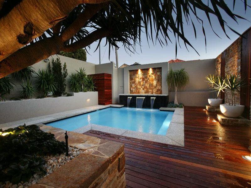 beautiful-landscape-lighting-around-pool-backyard-with-wooden-decks